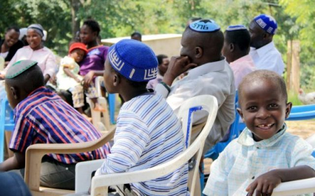 The Abayudaya Jewish community's members sit as they listen to their spiritual leader, in a village near Mbale, eastern Uganda, July 2, 2016. (AFP/Michael O'Hagan)