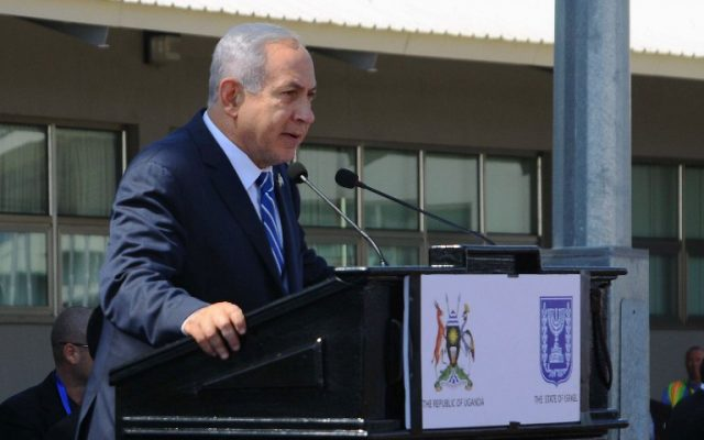 Prime Minister Benjamin Netanyahu speaks during an event to mark the 40th anniversary of the 1976 hostage rescue in Entebbe, Uganda, July 4, 2016. (AFP/Ronald Kabuubi)