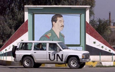 This file photo taken on February 2, 2003 shows a UN disarmament experts vehicle passing by a portrait of Iraqi President Saddam Hussein as they arrive at a milk factory in Abu Gharib, 15 kms west of Baghdad (AFP PHOTO / AHMAD AL-RUBAYE)