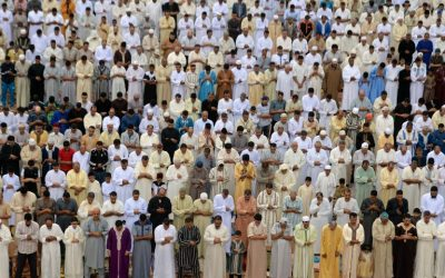 Moroccan Muslim men perform prayers for Eid al-Fitr, which marks the end of the Muslim holy fasting month of Ramadan in the city of Sale, north of the Moroccan capital Rabat on July 6, 2016. (AFP Photo/Fadel Senna)