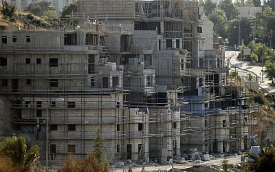 Buildings under construction in the Jewish settlement of Kiryat Arba outside Hebron, July 6, 2016.(AFP/Hazem Bader)