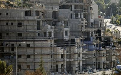 Buildings under construction in the Jewish settlement of Kiryat Arba outside Hebron, July 6, 2016 (AFP/Hazem Bader)