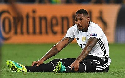 Germany's defender Jerome Boateng sits on the pitch during the Euro 2016 semi-final football match between Germany and France at the Stade Velodrome in Marseille on July 7, 2016. (AFP PHOTO/PATRIK STOLLARZ)