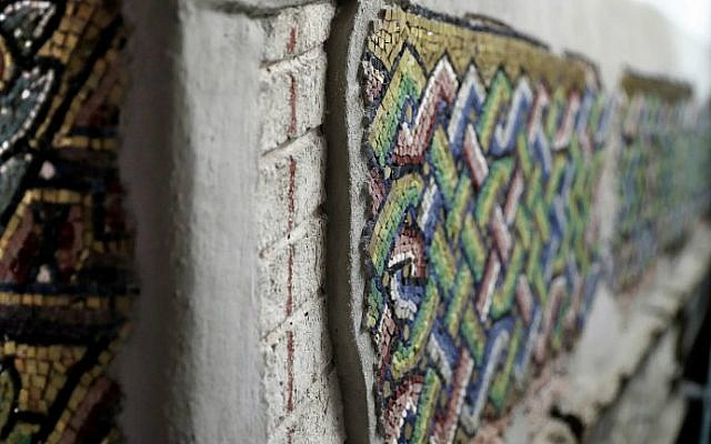 A close up shot shows details of a renovated mosaic wall inside the Church of the Nativity, renovated by Italian experts, in the biblical West Bank town of Bethlehem on July 8, 2016. (Thomas Coex/AFP)