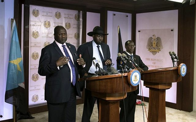 First Vice President Riek Machar (L) delivers a speech to journalists next to South Sudan President Salva Kiir (C) and Vice President James Wani Igga (R) prior to the shooting outside the presidential palace in Juba on July 8, 2016. (AFP PHOTO/Charles Atiki Lomodong)