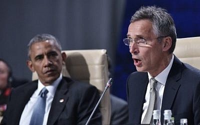 NATO Secretary General Jens Stoltenberg (R) and US President Barack Obama take part in a working session on Afghanistan during the NATO Summit at the Polish National Stadium in Warsaw on July 9, 2016. (AFP PHOTO / MANDEL NGAN)