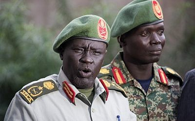 Former Sudan People's Liberation Army (SPLA) chief of general training and former in-opposition general Dau Athorjang (L) speaks during a press conference, pledging his allegiance to the SPLA on July 10, 2016 in Juba. (AFP PHOTO/CHARLES ATIKI LOMODONG)