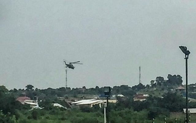 South Sudanese government attack helicopters hover over the Checkpoint district of the capital Juba, near the Jebel district which has seen some of the heaviest fighting, on July 11, 2016.  (AFP PHOTO / STR)