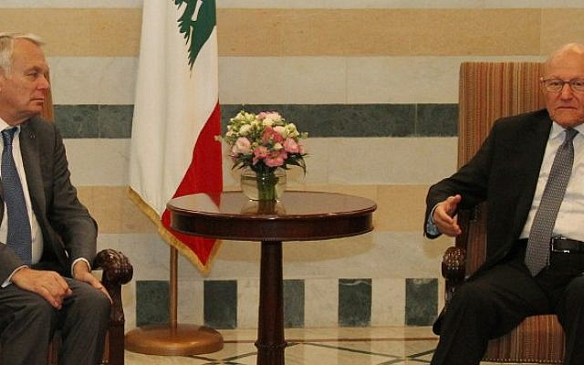 Lebanese Prime Minister Tammam Salam meets with French Foreign Minister Jean-Marc Ayrault at the Lebanese government palace in downtown Beirut, July 12, 2016. (AFP Photo/Anwar Amro)