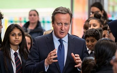Britain's Prime Minister David Cameron is pictured during a visit to Reach Academy Feltham in south west London, on July 12, 2016. (AFP/ CHRIS J RATCLIFFE)
