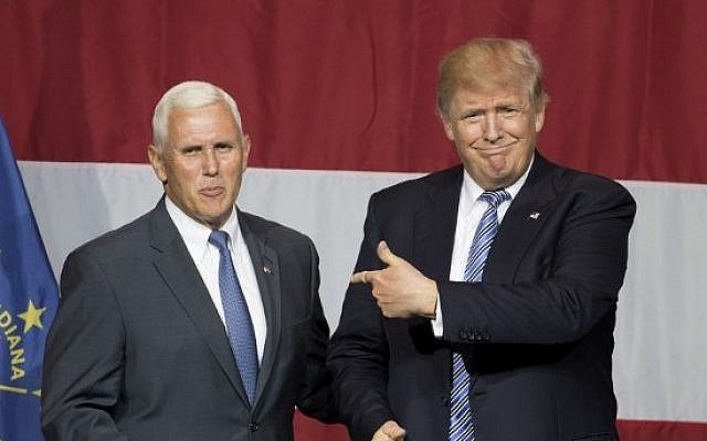 Presumptive US Republican presidential candidate Donald Trump (R) and Indiana Governor Mike Pence take the stage during a campaign rally at Grant Park Event Center in Westfield, Indiana, on July 12, 2016.  (AFP Photo/Tasos Katopdis)