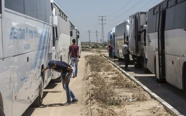 Illustrative: Buses received on July 13, 2016, on the Palestinian side of Israel's Erez border crossing with the Gaza Strip in the first such delivery since 2007. (AFP Photo/Mahmud Hams)