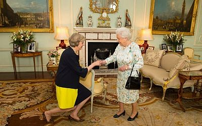 The new leader of the Conservative Party Theresa May, left, is greeted by Britain's Queen Elizabeth II in Buckingham Palace on July 13, 2016 where the queen invited the former home secretary to become prime minister and form a new government. (AFP/ POOL / Dominic Lipinski)