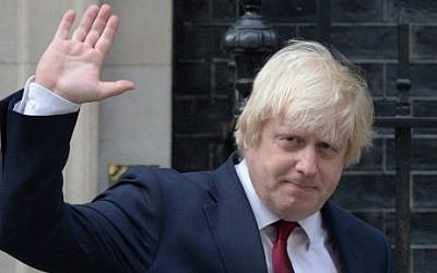 Newly appointed Foreign Secretary Boris Johnson waves as he leaves 10 Downing Street in central London on July 13, 2016 after new British Prime Minister Theresa May took office. (AFP PHOTO / OLI SCARFF)