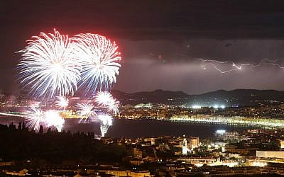A picture taken on July 14, 2016 shows a flash of lightning as fireworks explode over the French Riviera city of Nice, southeastern France, as part of France's annual Bastille Day Celebrations. (Valery Hache/AFP)