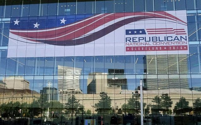 The skyline of downtown Cleveland, Ohio is reflected on the windows of the Convention Center July 14 2016, days before the city hosts the Republican National Convention. (AFP PHOTO / Eva HAMBACH)