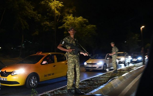 A Turkish security officer stands on guard on the side of the road on July 15, 2016 in Istanbul, during a security shutdown of the Bosphorus Bridge. (AFP PHOTO/BULENT KILIC)