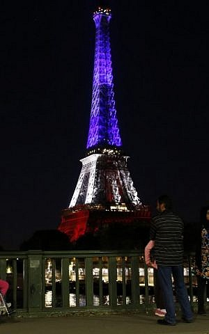 A picture taken on July 15, 2016 shows the Eiffel Tower in Paris illuminated with the colours of the French National flag in tribute for the victims of the Bastille Day attack in Nice that killed 84 people. (AFP PHOTO/MATTHIEU ALEXANDRE)