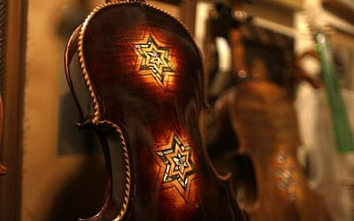 A violin which is part of a collection of old violins that were formerly owned by European Jews during the Holocaust, July 15, 2016 . (AFP PHOTO / MENAHEM KAHANA)