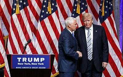 US Republican presidential candidate Donald Trump (R) shakes hands with vice presidential candidate Mike Pence on July 16, 2016, during a press conference in New York. (AFP PHOTO/KENA BETANCUR)