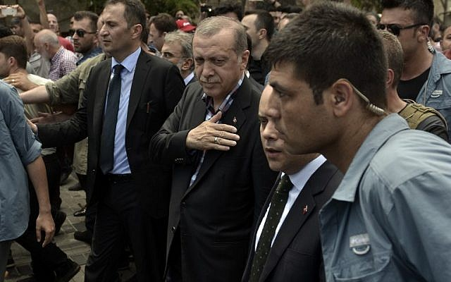 """Turkish President Recep Tayyip Erdogan vowed on July 17 to purge the """"virus"""" within state bodies, during a speech at the funeral of victims killed during the coup bid he blames on his enemy Fethullah Gulen. (AFP PHOTO / ARIS MESSINIS)"""