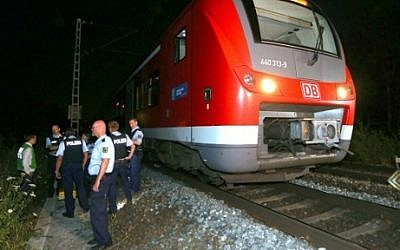Police officers stand by a regional train in Wuerzburg southern Germany on July 18, 2016 after a man attacked train passengers with an axe. (AFP PHOTO / dpa / Karl-Josef Hildenbrand)
