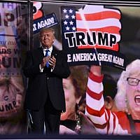 Republican presidential candidate Donald Trump arrives on stage on the first day of the Republican National Convention on July 18, 2016 at Quicken Loans Arena in Cleveland, Ohio. (AFP/TIMOTHY A. CLARY)