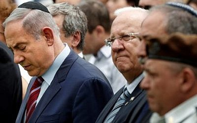 From left: Prime Minister Benjamin Netanyahu, President Reuven Rivlin, Defense Minister Avigdor Lieberman, and IDF Chief of Staff Lt. Gen. Gadi Eizenkot attend an official memorial ceremony marking the tenth anniversary of the 2006 war between Israel and Lebanon's Hezbollah at the military cemetery on Mount Herzl in Jerusalem, July 19, 2016. (AFP Photo/Thomas Coex/File)
