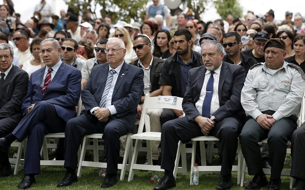 (Front from L to R) Prime Minister Benjamin Netanyahu, President Reuven Rivlin, Defense Minister Avigdor Lieberman and IDF Chief of Staff General Gadi Eizenkot attend an official memorial ceremony marking the tenth anniversary of the Second Lebanon War at the military cemetery of Mount Herzl in Jerusalem on July 19, 2016. (AFP PHOTO/THOMAS COEX)