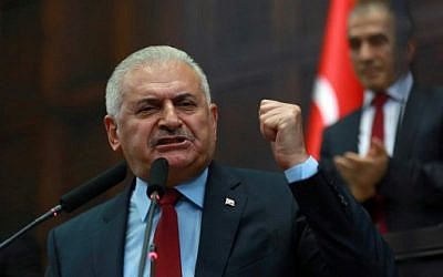 Turkish Prime Minister and the leader of Turkey's ruling party, the Justice and Development Party (AK Party) Binali Yildirim speaks during the AK Party's group meeting at the Grand National Assembly of Turkey (TBMM) in Ankara, July 19, 2016.  (AFP/ADEM ALTAN)