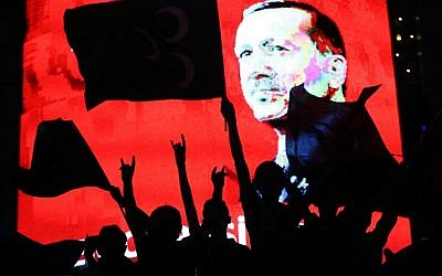 Supporters stand in front of a screen displaying a portrait of Turkish President Recep Tayyip Erdogan during a rally at Kizilay Square in Ankara on July 20, 2016. (AFP/Adem Altan)