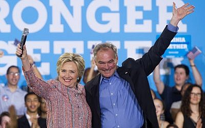 US Democratic presidential candidate Hillary Clinton and US Senator Tim Kaine of Virginia seen at a campaign rally in Annandale, Virginia, on July 14, 2016. (AFP/Saul Loeb)