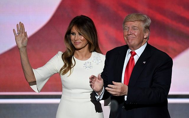 US Republican presidential candidate Donald Trump stands with his wife Melania on the final night of the Republican National Convention at the Quicken Loans Arena in Cleveland, Ohio on July 21, 2016. (AFP PHOTO/Jim WATSON)