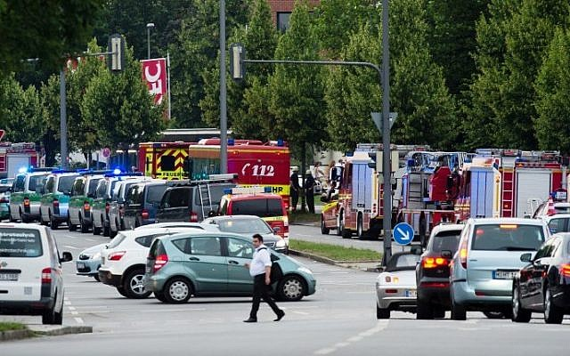 Police and firefighters are seen near a shopping mall amid a shooting on July 22, 2016 in Munich. (AFP PHOTO / dpa / Matthias Balk)
