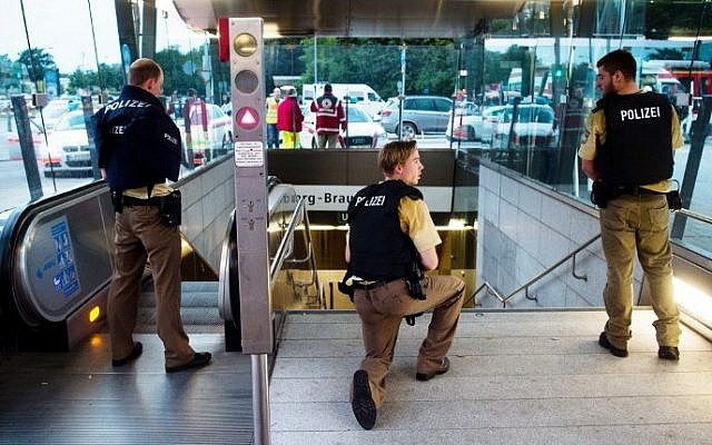 Police secures the entrance to a subway station near a shopping mall where a shooting took place on July 22, 2016 in Munich. Several people were killed on Friday in a shooting rampage by a lone gunman in a Munich shopping center, media reports said. (Lukas Schulze/DPA/AFP)