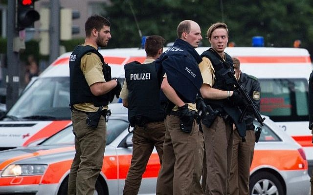 Police secures the area near a shopping mall following a shooting on July 22, 2016 in Munich. Several people were killed on Friday in a shooting rampage by a lone gunman in a Munich shopping center, media reports said. (Matthias Balk/DPA/AFP)