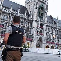 Illustrative: A policeman stands guard at the Marienplatz square in Munich, southern Germany, on July 22, 2016 (AFP PHOTO/dpa/Sven Hoppe )