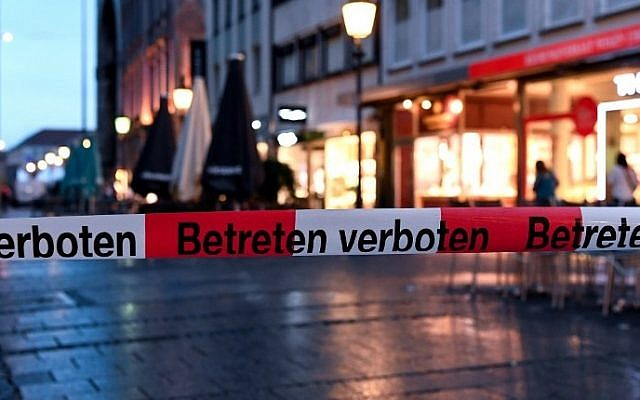 Police sign blocks the entrance to Odeon square following shootings at a shopping mall earlier on July 22, 2016 in Munich. (AFP Photo/dpa/Sven Hoppe)
