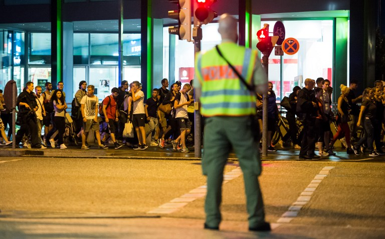 People are evacuated from the area around the shopping mall Olympia Einkaufzentrum OEZ in Munich, Germany on July 22, 2016 after gunmen went on a shooting rampage in the busy shopping center, killing nine people before taking his own life. (AFP PHOTO/STRINGER)