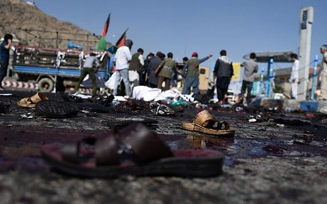 The sandals of Afghan protesters seen at the scene of a suicide attack that targeted crowds of minority Shiite Hazaras during a demonstration at the Deh Mazang Circle in Kabul on July 23, 2016. (AFP / WAKIL KOHSAR)