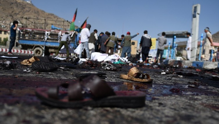 The sandals of Afghan protesters seen at the scene of a suicide attack that targeted crowds of minority Shiite Hazaras during a demonstration at the Deh Mazang Circle in Kabul on July 23, 2016. (AFP/Wakil Kohsar)