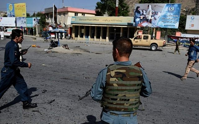 Afghan security personnel arrive after a suicide attack that targeted crowds of minority Shiite Hazaras during a demonstration at the Deh Mazang Circle of Kabul on July 23, 2016. (AFP/ WAKIL KOHSAR)