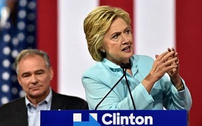 US Democratic presidential candidate Hillary Clinton introduces her running mate US Senator Tim Kaine at a campaign rally at Florida International University in Miami, July 23, 2016. (AFP Photo/Gaston De Cardenas)