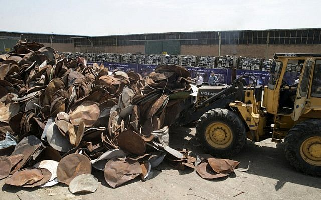 Satellite dishes and receivers before being destroyed during a ceremony in the Iranian capital Tehran, July 24, 2016. (AFP PHOTO / TASNIM NEWS / HOSSEIN ZOHREVAND)