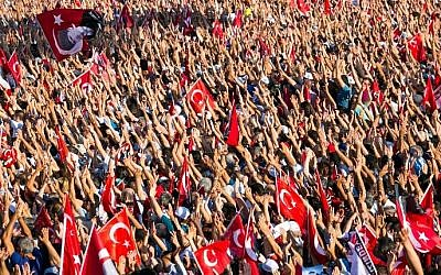 People wave Turkish flags and portraits of modern Turkey's founding father Mustafa Kemal Ataturk, during a rally organized by the main opposition group, the Republican People's Party (CHO), on July 24, 2016 in Istanbul's Taksim Square. (AFP/Gurcan Ozturk)