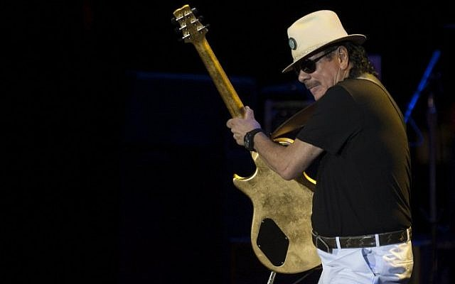 Mexican-born US guitarist Carlos Santana performs on stage during a concert at the Starlite music festival in Marbella on July 24, 2016. (AFP PHOTO / JORGE GUERRERO)