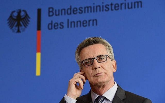 German Interior Minister Thomas de Maiziere addresses the press on the attacks in Reutlingen and Ansbach in Berlin, on July 25, 2016. (AFP/Tobias Schwarz)