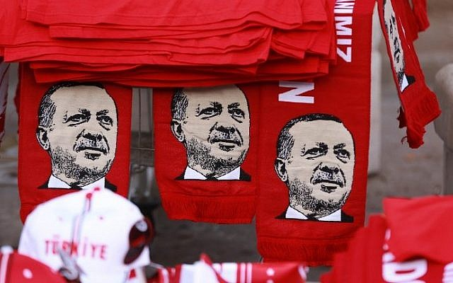 This picture taken on July 25, 2016, shows scarves with the effigy of Turkish President Recep Tayyip Erdogan a rally against the military coup in Ankara. (AFP/Adem Altan)