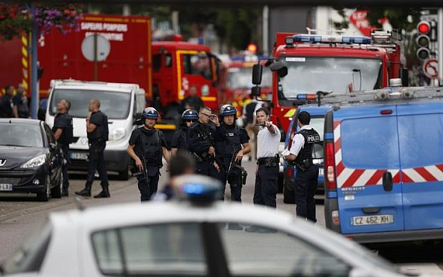French police officers and fire engine arrive at the scene of a hostage-taking at a church in Saint-Etienne-du-Rouvray, northern France, on July 26, 2016 that left the priest dead.(AFP PHOTO / CHARLY TRIBALLEAU)