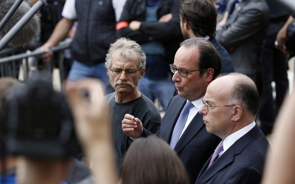 French President Francois Hollande (C) flanked by Hubert Wulfranc mayor of Saint-Etienne-du-Rouvray (L) and French Interior Minister Bernard Cazeneuve (R), speaks to the press as he leaves the Saint-Etienne-du-Rouvray's city hall following a hostage-taking at a church of the town on July 26, 2016 left a priest dead. (AFP PHOTO/CHARLY TRIBALLEAU)